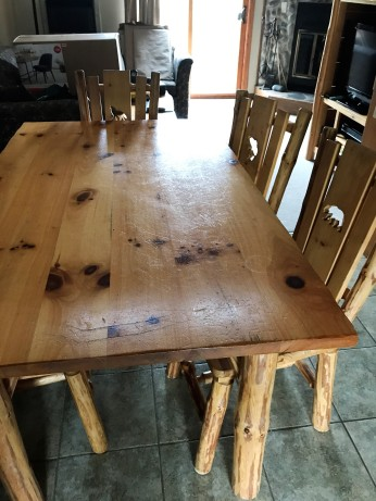 Former dining room table with wooden chairs :/