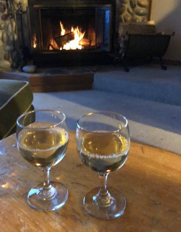 wine glasses and a wood fireplace, 142C at Caribou Highlands in Lutsen MN